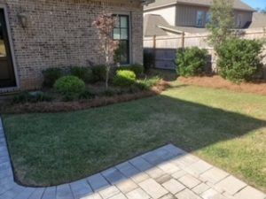 Gorgeous greenery for a new flower bed by DC Lawn & Landscape in Fairhope, AL