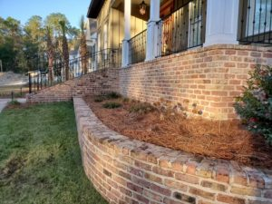 Raised pine straw bed installed by DC Lawn & Landscape in Fairhope, AL