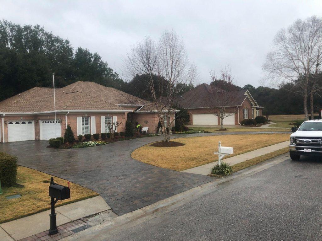 Beautiful paver driveway by DC Lawn & Landscape in Fairhope, AL