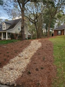Drainage job to improve water flow by DC Lawn & Landscape in Fairhope, AL