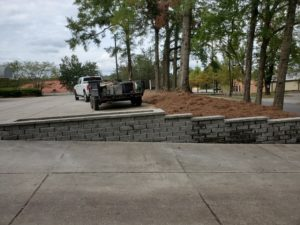 Paver and retaining wall with fresh pine straw by DC Lawn & Landscape in Fairhope, AL