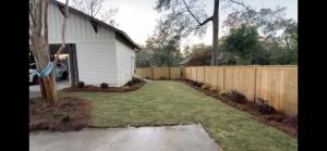 Landscape in a backyard with pine straw and sod by DC Lawn & Landscape in Fairhope, AL