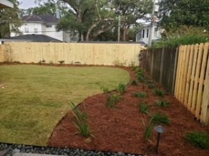 Bed installed with pine straw and monkey grass by DC Lawn & Landscape in Fairhope, AL