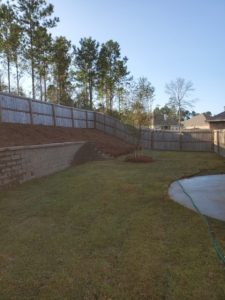 Retaining wall with pine straw bed by DC Lawn & Landscape in Fairhope, AL