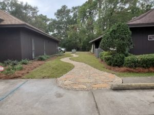 New sidewalk with rock and pavers by DC Lawn & Landscape in Fairhope, AL