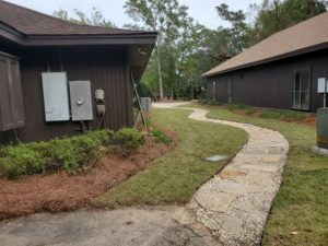 Newly installed sidewalk with pavers and rocks by DC Lawn & Landscape in Fairhope, AL