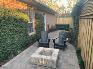 Pavers with square firepit by DC Lawn & Landscape in Fairhope, AL
