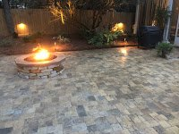 Beautiful paver patio with new firepit by DC Lawn & Landscape in Fairhope, AL