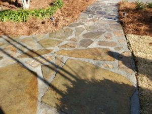 Unique flagstone pathway surrounded by fresh straw done by DC Lawn & Landscape in Fairhope, AL