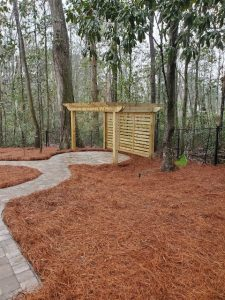 Pine straw surrounding a new pergola by DC Lawn & Landscape in Fairhope, Alabama