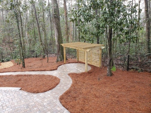 Pergola and new pine straw installed by DC Lawn & Landscape in Fairhope, Alabama