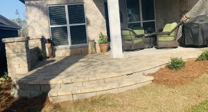 patio and columns by DC Lawn & landscape in Fairhope, Alabama