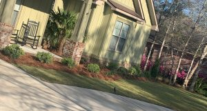 front porch design by DC lawn and Landscape in Fairhope, Alabama