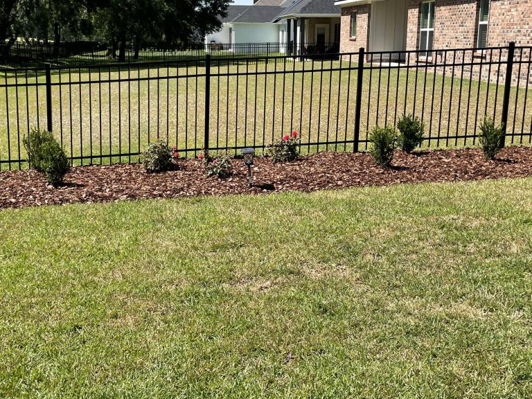 mulch bed with new shrubs and flowers done by DC lawn and landscape in Fairhope, Al