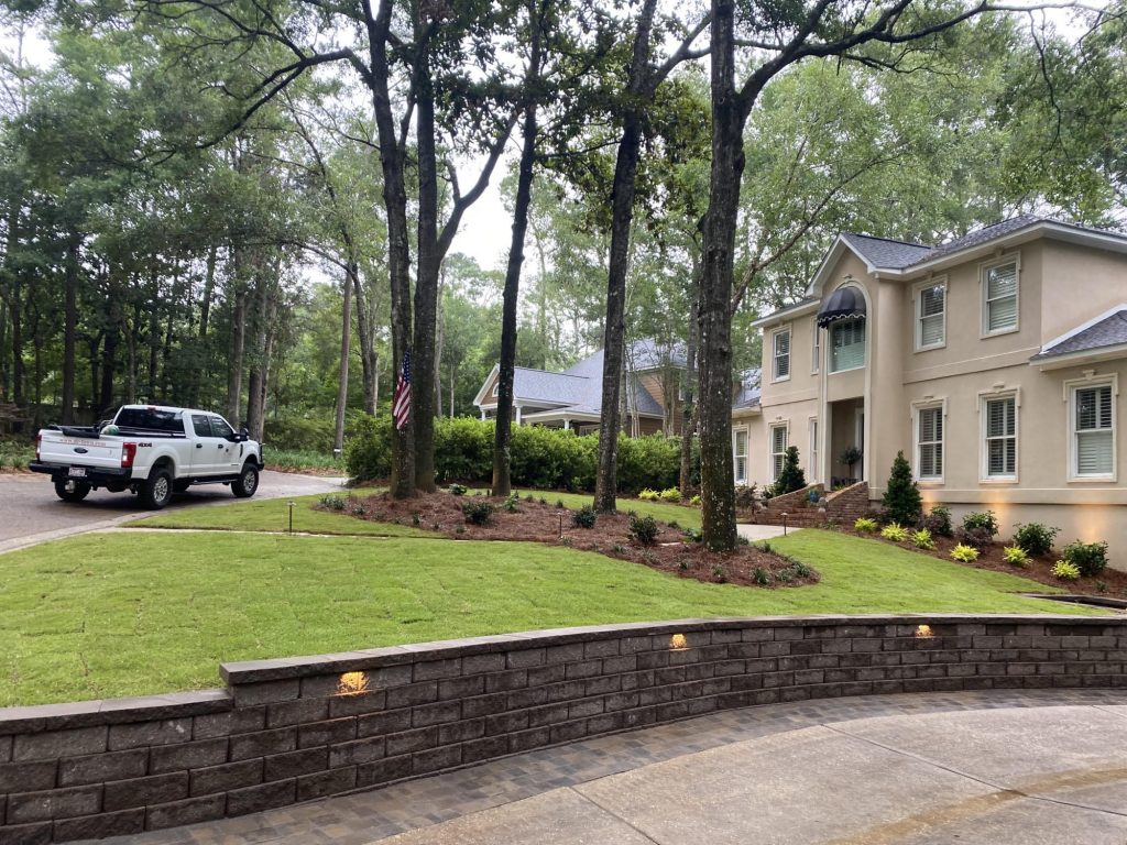 complete retaining wall install by DC lawn and Landscape in Fairhope, AL