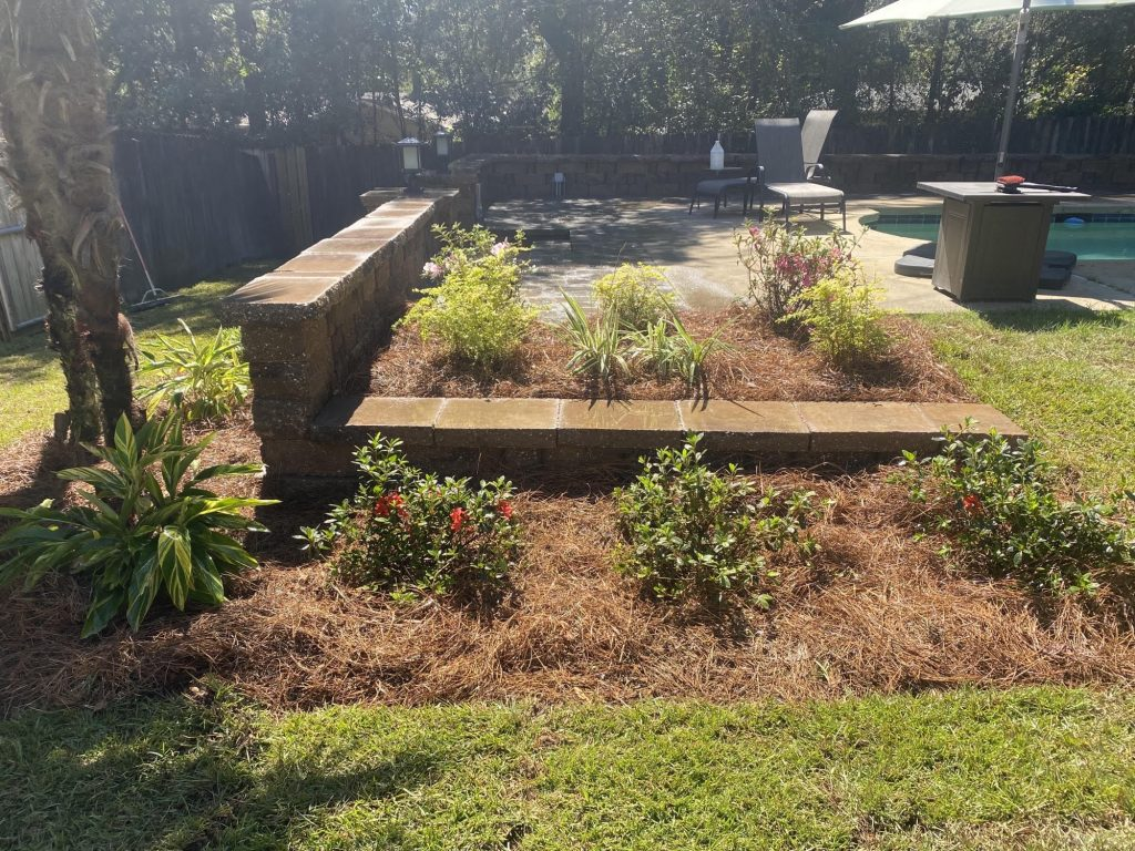retaining wall by dc lawn & landscape
